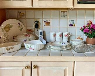 Full set of dishes with fruit and flower pattern, including casserole and serving dishes. $60