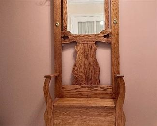 Antique oak Hall Tree. Excellent condition with carved wood details and storage seat. Negotiable.
