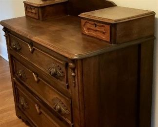 Antique three drawer chest has hanky drawers & carved pulls