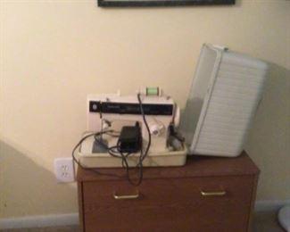 Singer portable sewing machine& shoe storage