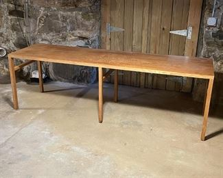 CUSTOM LONG WORK TABLE   Custom made for a 14th street office, relocated last year; h. 29 x 93-1/2 x 26 in.