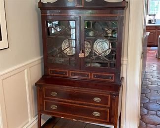 ANTIQUE SECRETARY BOOKCASE | Having glazed cabinet doors with geometric patterns (glass separated by muntins), over a fold-down writing surface over two full-width drawers; h. 76 x 42 x 19 in.