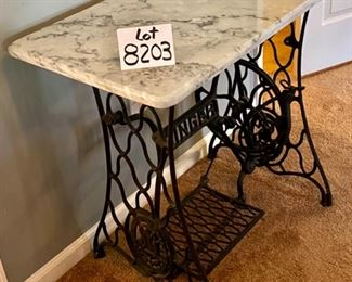 """Lot 8203. $225.00 Wrought Iron """"Singer"""" Treadle base with marble top. Super Cute Table. 31.5"""" W x 17"""" L x 28.5"""" T"""