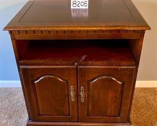"""Lot 8205. $60.00. Swivel Top TV Cabinet with pull out component shelf, blemishes as shown. 27.5"""" L  x 17"""" W x 31"""" T"""