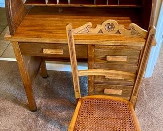 """Lot 8217 $125.00  Vintage Oak Roll Top Child's Desk with matching caned seat desk chair. Great accent or functional piece. (32""""w x 18""""d x 38.5""""l)"""