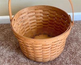"Lot 8219. $45.00  3 pcs  Longaberger 1993 signed handled apple basket. 13"" diam x 8"" T and 2 brass pails. Brass pails measure 11"" diam  x 7"" T and 13"" diam  x 8"" T. also includes one metal brass colored stand."