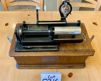 Lot 8216A  $425.00. Pre-sold to a Out of state Collector.   Edison Home Phonograph Combination Type Model D, serial # 341949.  Thomas A. Edison et al at Orange, NJ + Suitcase of Cylinder Records and Set of Collector Books about Cylinder Records from 1877-1929