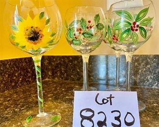 Lot 8230. $30.00. 5 hand painted wine glasses, 4 are poinsettia themed and one sunflower glass. Super Sweet!!