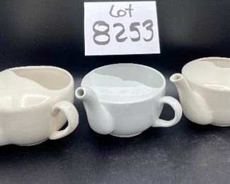 Lot 8253. $60.00  Lot of 9 white and cream colored self-feeders.