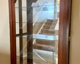 """Lot 8262. $650.00. Curio Cabinet With 2-Way Sliding Door, and Glass Shelves - Beautiful Display for your Valuables and Collectibles. Manufactured by Illuminated Furniture. Made in the USA. 40""""w x 12.5""""d x 77.5""""t"""