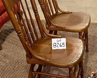 """Lot 8265.  $38.00 Pair of antique or vintage wooden chairs with carved spindle backs and two rag rug cushions.  16"""" W x 19"""" D x 37"""" T"""