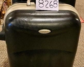 """Lot 8268.  $50.00. Two black, industrial hard-sided Samosonite TSA002, 4-wheeled suitcases. The smaller is a carry-on,  They are pretty indestructible!   1) 15"""" W x 9"""" D x 24"""" T,  2) 18"""" W x 10"""" D x 28"""" T"""