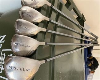"""Lot 8271. $235.00. Women's Taylor-Made Miscela RH Clubs, Ultralite Graphite- Ladies Flex 7 (Irons- 7, 8, 9, P, S) & (Woods 1, 3, 4, 5, 7), Odyssey """"White Hot"""" 2-ball blade putter. Excellent condition, Head covers may be available but aren't shown.  What a deal!"""