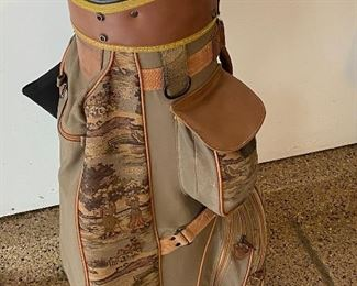 Lot 8272. $85.00. Vintage Bennington Golf Cart Bag, Brown and tan colors with golfers on bag. Lone Palm golf towel and 4 cammo head covers (Cover shown does not belong with this Bag, which btw was used by a woman golfer, and it's cute.