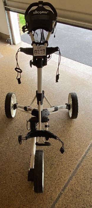 Lot 8273. $180.00. Clicgear Model 3.5+ bag pull cart, easily folds up to fit in your trunk.  New these carts cost $500+. If Tesla made a Golf Cart this would be the one.
