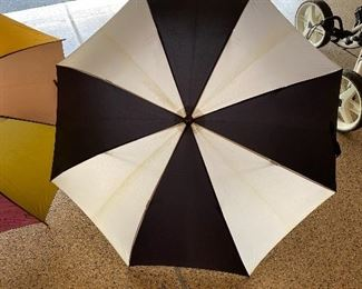 Lot 8283. $20,00  3 umbrellas. 1 golf umbrella, 1 reg, 1 compact travel. One for the car, one for the Golf Course and one for your office...