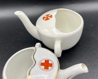 """Lot 8257.  $60.00. Lot of 6, side-handled infant/hospital/invalid feeders all with some design.  1) Red Cross, #4767 on bottom, 2) red, yellow & blue design and image of baby, 3) Red Cross/gold trim, marked """"98"""" on bottom, 4) Pink & plum floral, marked """"7317"""", 5) Purple floral with gold, 6) blue floral.  Our favorite lot."""
