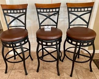 """Lot 8286.$120.00 3 metal frame swivel bar stools from, 300 lb max.weight load, wood accent on back with faux brown leather seats. 45""""t x 29"""" seat height x 18"""" dia"""