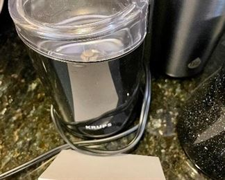 Lot 8289. $38.00. Krups Coffee/Spice Grinder, 2 like new TAL thermal 18 oz cups, a pair of shakers, 1 scoop, and a Hotjo Highwave 93030 Black Speckle Mug.