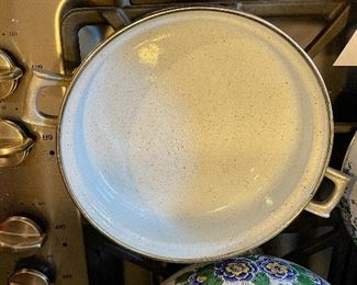 """Lot 8291. $95.00. 1851 ASTA German Enamel Cookware, 7 pc. 10"""" fry pan w/lid, 10"""" dia dutch oven w/lid, 2 double handled pans, 8""""dia x 2.5""""t pan (no lid), 8"""" dia x 5""""T pan (no lid), 6.5"""" lid - no pan. Purple, gold, green floral patterns."""