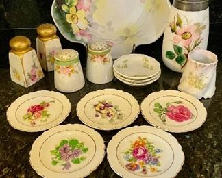 Lot 8296. $45.00. Beautiful and colorful 15 pc. mixed lot of antique hand-painted pieces.  1 pc Lampnan ?painted s&p, 1 pr Nippon hand painted s&p shakers, porcelain hand, set of 3 Johnson Bros tea bag saucers, and set of 5 painted floral theme plates with gold trim. Photo describes better than me!