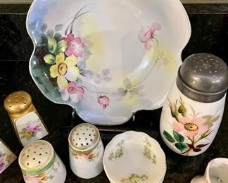 Lot 8296. $45.00. Beautiful and colorful 15 pc. mixed lot of antique hand-painted pieces.  1 pc Lampnan painted s&p, 1 pr Nippon hand painted s&p shakers, porcelain hand, set of 3 Johnson Bros tea bag saucers, and set of 5 painted floral theme plates with gold trim. Photo describes better than me!