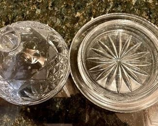 """Lot 8305. $30.00 7 pc lot of cut glass serving pieces: covered butter dish, candle stick, cruet with stopper, divided relish tray, domes covered dish (6"""" Diam x 4.5"""" T), lg. bowl (8.5"""" x 5""""T), 11"""" diameter plate - great serving piece)."""