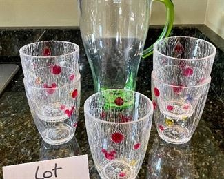 """Lot 8340. $20.00 An 11"""" green plastic pitcher with lid (BPA free) and 5 cute Disney glasses in as is condition (not dishwasher safe!)"""