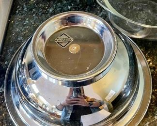 """Lot 8344.  $42.00  Vintage mid-Century modern Kromex serving bowl (11.5"""" diam) with in 8"""" glass insert,  and a 'Kromex' tray with brass handles (17"""" L x 7"""" W)35 salad/dessert forks with glass buffet caddy."""