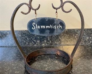 """Lot 8346. $65.00  Stammtisch"""" German ashtray in iron holder. 11"""" W x 11.5"""" T.  Stammtisch is to reserve a table for Regulars that meet at the restaurant or bar."""