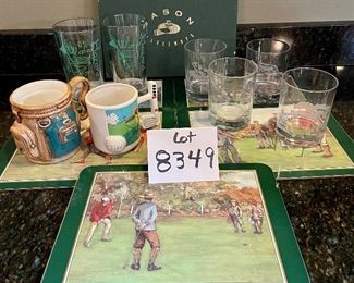Lot 8349. $35.00. Golf beverage assortment including 5 Jason vintage golf scene placemats, 4 Old Fashioned glasses, each with an etched design of different courses - Augusta, Pinehurst, Firestone & Doral- with hole stats; 2 golf themed cups and 2 golf themed tumblers.
