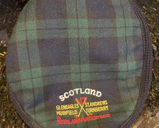 Lot 8350.  $45.00. Black Watch plaid golf hat (tam) from Ghillie Products Scotland featuring Glen Eagles, St. Andrews, Muirfield and Turnberry on the front of the hat.  Also included are a miniature golf bag clock and a Jasperware golf themed mini plate.