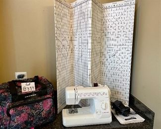 """Lot 8359.  $125.00  Janome Portable Sewing Machine with travel case - Model 659- and 72"""" x 36"""" cardboard cutting grid."""