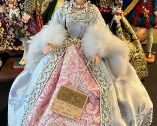 Lot 8361. $200.00.  Lot of 11 hand-dressed English dolls made at 'The Little Gallery', Penzance.  Included are: Edward VI, Sir Walter Raleigh, Henry VIII, and the following wives of Henry VIII; Anne Boleyn II wife of Henry, Anne of Cleves 4th wife of Henry, Catherine of Aragon, daughter of King Henry VIII, Jane Seymore 3rd wife of Henry,  and the doll in the pink, dubbed Queen of hearts by HenryVIII. The dolls are no doubt Barbie's, however the costumes are period true and are truly amazing.