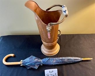 """Lot 8365.  $55.00 Brass umbrella stand with Delft porcelain handle, made in Holland.  22"""" T x 11"""" W, includes blue paisley print umbrella."""