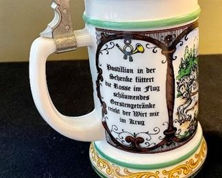 Lot 8372. $60.00  Lot of 3 German covered Beer Steins as shown.