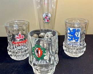 Lot 8375.$48.00 Lot of 5 Glass Mug Beer Steins and 1 Pilsner Glass adorned with Logos for Beer Companies.