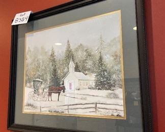 """Lot 8384.$45.00  Pencil signed C. Smith,  Pretty hoiday framed art, a winter scene with church and horse and buggy print in a black wood frame.27"""" x 23"""""""