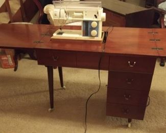Sewing table from Sears, damage to top. Not original mounting hardware for sewing machine but works. Vintage Husqvarna Viking Sarah Embroidery machine, working condition.