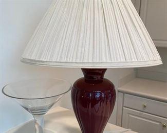 Burgundy ceramic lamp and oversized martini glass