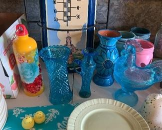 Colorful turquoise glass and other items.