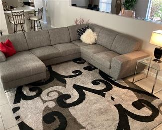 Stunning Euro styled sectional 11'x8' (pillows included)