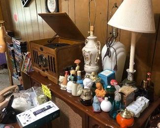 Avon bottles, Lamps, old telephones and an old record player