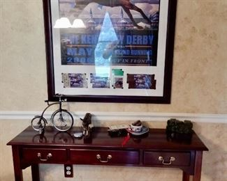 NICELY FRAMED 2006 KENTUCKY DERBY POSTER WITH TICKETS ($85).  NICE SOFA OR ENTRY TABLE $185.