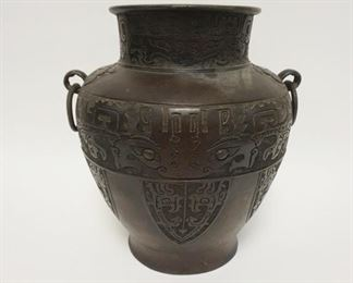 1002ANTIQUE BRONZE DOUBLE RING HANDLED URN WITH CHARACTER MARKS ON BASE. PREVIOUSLY DRILLED FOR A LAMP, 12 IN HIGH