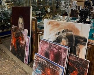 various different paintings and canvases