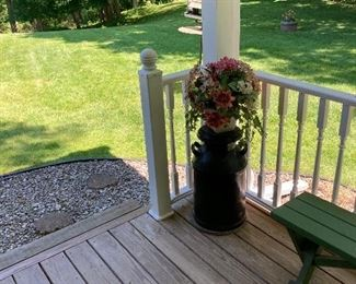 Black painted milk can and flowers