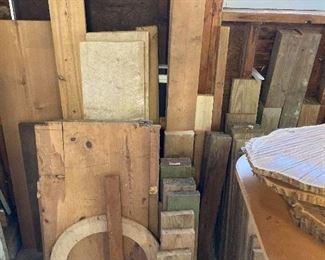 Large assortment of wood including oak, walnut, cedar and deck board