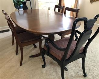 """$400 This lovely, vintage mahogany double pedestal dining table has a pretty banded edge. Lots of legroom gives you the versatility to add seats with the double pedestal base. Legs are finished with brass lions foot caps. Measures 72"""" with out leaves. Opens to 90"""" or 108"""" with leaves. Well cared for, perfect condition."""