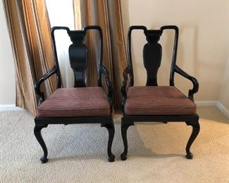 $100 This is an elegant pair of vintage dining chairs with fine Asian lines. Black ebony color with reddish multi-color upholstery. Use as head chairs at the dining table or as side chairs in other locations. Solid wood...Just beautiful!